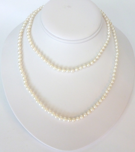 A 36 inch long string of small and perfect AAA grade white pearls